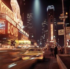 45th Street and Broadway are illuminated at night in 1970.