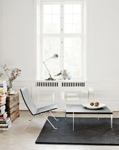 Beautiful simplicity, love the stacked books and table for one.