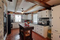 open shelving kitchen with tin backsplash - Google Search