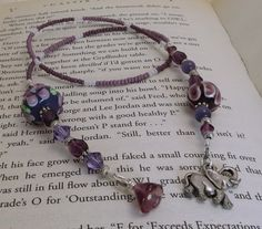 One of my bookmarks! Made with beautiful handmade lampwork beads and an elephant dangle. (This one seems right for a Discworld book, eh?)