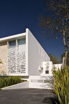 Playful And Quirky Details Influencing Lighting: Casa Natalia by Agraz Arquitectos