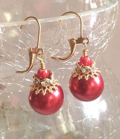 A personal favorite from my Etsy shop https://www.etsy.com/listing/258591108/red-glass-pearl-bridal-earrings