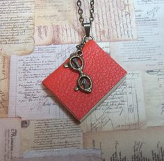 Miniature Book Necklace in Orange Leather by TheBookCellar on Etsy, $24.00