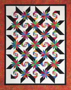 Lemoyne Trails a smashingly designed quilt from Certified Instructor Pam Goggans. This is a great stash busting quilt designed to go along with my Rapid Fire Lemoyne Star and Square Squared tools.