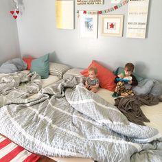 Family bed. Bed sharing. Co sleeping. Co sleeper. Family bedroom.  Wall gallery. Gallery wall. Floor bed. Bed on floor. Boho bedroom.