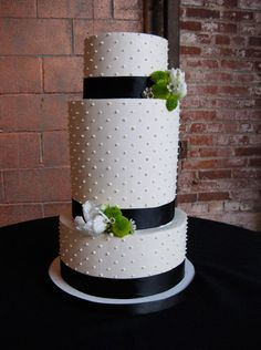 I think this is very elegant and pretty. If I had to pick a cake for you wedding, this one would be it.