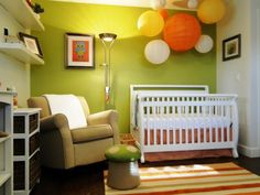 woodsy modern girls nursery. So adorable and cozy! I can just imagine rocking a baby to sleep in this room!