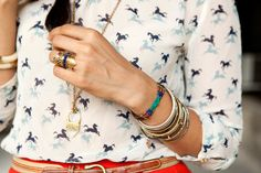 love that ring & arm candy. blouse & colored pants are cute too =)