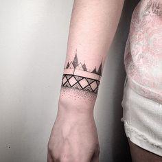Geometric wristband tattoo by daniel matsumoto