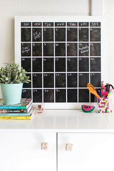 Make a DIY simple chalkboard calendar to erase and reuse monthly to keep your life organized!
