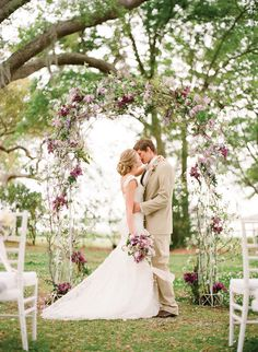Gorgeous floral arch and pre-ceremony shot.