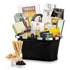 This spectacular gourmet gift bag makes an impressive statement of your generosity and esteem for corporate gifts, Christmas, weddings, birthdays, and other important occasions. A black Reisenthel Carry Bag overflows with the finest European sweets and savories.
