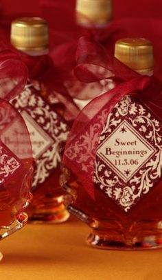 my maple syrup wedding favors but with purple and gold tags and syrup provided by husband's uncle maple syrup business