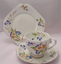 """Lovely ART DECO tea trio from 1937 by Roslyn china and the delightful """"ELY"""" pattern. Beautiful octagonal plate, scalloped saucer and fluted pedestal cup with cornflower blue and white flowers. Very pretty and in EXCELLENT condition See more pics and make it your own for a bargain price on eBay at http://www.ebay.co.uk/itm/271585703198"""