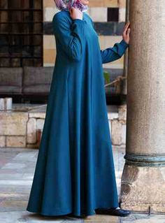 Easy Care Flared Abaya Teal color You asked for it, and we are happy to oblige: Finally, a wrinkle-resistant version of our popular abayas! The name says it all, and it's as easy to wear as it is to care for. Elasticized sleeves, a front opening, and the perfect flattering, feminine flair work together to create one beautiful, practical piece you'll be reaching for day after day.   Price: $124.95 $109.95