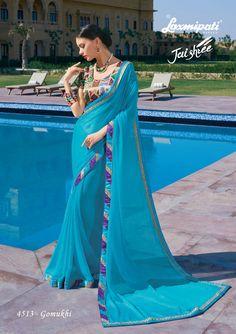 Browse this Blue Chiffon Saree and Multicolor Bhagalpuri Silk Blouse along with Fancy Fog Work Lace Border online at www.laxmipati.com #Catalogue #JAISHREE #DesignNumber: 4513 #Price - ₹ 3208.00  #Bridal #ReadyToWear #Wedding #Apparel #Art #Autumn #Black #Border #MakeInIndia #CasualSarees #Clothing #ColoursOfIndia #Couture #Designer #Designersarees #Dress #Dubaifashion #Ecommerce #EpicLove #Ethnic #Ethnicwear #Exclusivedesign #Fash Laxmipati Sarees, Lehenga Saree, Sari, Fancy Sarees, Party Wear Sarees, Dubai Fashion, Chiffon Saree, Daily Wear, Ready To Wear