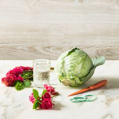 DIY Cabbage Flower Centerpiece - Southern Living  Materials  -1 large cabbage with pretty outer leaves  -1 small Mason jar or glass  -Paring knife  -3 bunches of flowers in shades of pink (we used: tulips, hyacinth, spray roses)  -Rubber bands  -Greenery from the yard Check out the HOW TO VIDEO: https://www.facebook.com/SouthernLiving/videos/10152815949641463/?pnref=story