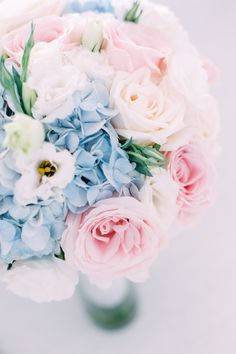 (Messy-shape) White eustoma, White orchid, Ivory rose, soft pink rose and touch of blue hydrangea.