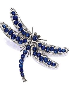 SAPPHIRE AND DIAMOND 'DRAGONFLY' BROOCH, composed of thirty-six cabochon sapphires together weighing approximately carats, embellished by circular-cut diamonds together weighing approximately carats, mounted in 18 karat blackened gold. Dragonfly Jewelry, Dragonfly Art, Insect Jewelry, Animal Jewelry, Antique Jewelry, Vintage Jewelry, Sapphire Jewelry, Royal Jewels, Schmuck Design