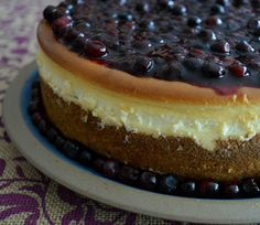 My favorite creamy cheesecake recipe is perfect with huckleberries, or other seasonal fruits, that have been warmed up with a taste of sugar and cinnamon.