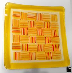 Basket-Weave... multiple fires, stringers formed and fused, then that plate cut into square. I could do this!