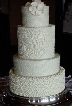Love the attention to details on this cake.  White on white wedding cake. How amazingly subtle.