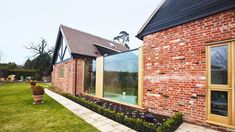a link extension to some converted brick farm buildings | Home Extension | Interior Design | Real Homes Extension Designs, Glass Extension, Extension Ideas, Sliding Pocket Doors, Glazed Walls, Door Images, Residential Architect, Planning Permission, Glass Roof