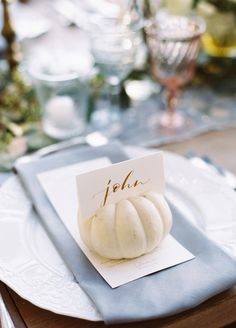 A mini pumpkin makes the most adorable place card holder for your dinner guests. Pumpkins can be painted to suit any style wedding!
