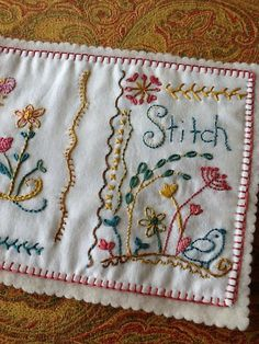Embroidered stitch book cover by debbiejones12, via Flickr