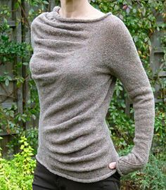 This is a seamless sweater knitted from the top down. The sleeve stitches are put on waste yarn whilst working on the body, and transferred back to working needle(s) to complete in the round.