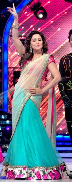 sister of the bride - sangeet  Madhuri Dixit in sky blue net half saree with floral border, white duppata and pink blouse