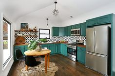 Love the teal kitchen cabinets combined with the black and white backsplash tile Painting Kitchen Cabinets, Kitchen Backsplash, Teal Cabinets, Turquoise Cabinets, Colorful Kitchen Cabinets, Bright Kitchen Colors, Cement Tile Backsplash, Fireclay Tile, Backsplash Ideas