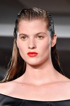 Yet again, the wet hair look turned up on the runways, though, this season, it wasn't about slicking hair back. Instead, it was parted on the side, creating a sexy (and almost masculine!) combover. Worn down at Zac Posen, others pinned it up, but all stuck with a sleek, pompadour style.   - ELLE.com