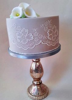 yesterday i did my first ever cake lesson at squires kitchen, sharp edge and something i have never done before brush embroidery, we did'nt have time to do it all there but i have done my best to finish. it's not great as my piping skills are not...