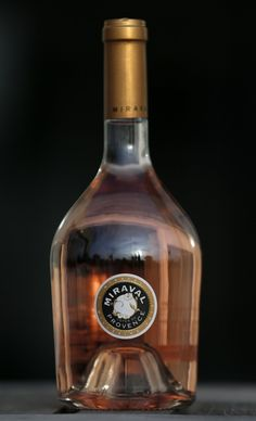 First wine from Brad Pitt and Angelina Jolie's French vineyard to hit Web  Miraval, Cote de Provence rosé wine is displayed in Paris. Credit: Reuters