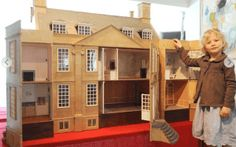 """The Bourton Dolls House -- This 1:12th scale, 24-room dolls house that replicates Bourton House at Bourton-on-the-Hill, Gloucestershire, sold at auction for just under £3,000. Referring to the photo attached to the story, the headline in a local paper read: """"If you want to sell a dolls house, get a cute model."""" Read more about the Bourton Dolls House: http://dollhousedecoratingblog.com/2016/08/bourton-dolls-house.html"""