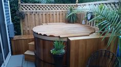 Backyard Retreat in a Great Northern Hot Tub with Roll-Up Cover Backyard Retreat, Western Red Cedar, Hot Tubs, Outdoor Furniture, Outdoor Decor, Patio, Garden, Cover, Home Decor