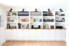 All about how we DIY'd our built in bookshelves using IKEA cabinets. Built In Shelves Living Room, Bookshelves Built In, Bookcases, Custom Bookshelves, Bookshelf Wall, Home Office Cabinets, Ikea Cabinets, Base Cabinets, Home Office Design