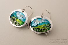 "You can almost smell that fresh mountain air when you wear this pendant.    Materials: Champleve & Cloisonne Enamels on Fine Silver.  Pendant      * Size: 1.5"" x 1.3""      * Includes 16"" Sterling Cable Chain.   Earrings      * Size: 0.9"" x 0.75""     * Sterling Ear Wires"