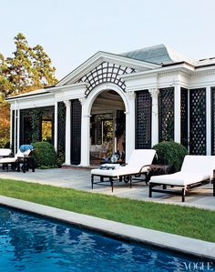 poolhouse with dark trellis front - @ Tory Burch's Southampton estate