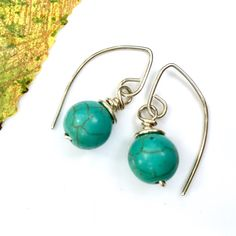 Great form! These curvaceous turquoise howlite earrings will be noticed.   • Handmade, wire-wrapped in 925 sterling silver • Gift-ready packaging with original-design gift card