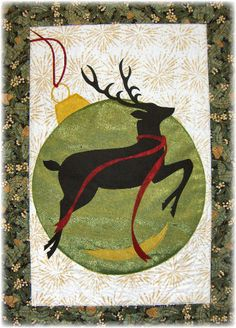 Christmas Reindeer, by June Jaeger. This applique art quilt provides a refreshing change to ordinary holiday quilts, and conveys a Pacific Northwest mood, as well. It reminds me of the iconic White Stag sign in Portland, Oregon.