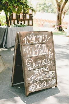 Wooden wedding sign: http://www.stylemepretty.com/2014/10/29/vintage-chic-winery-wedding-with-pops-of-purple/ | Photography: Onelove - http://www.onelove-photo.com/