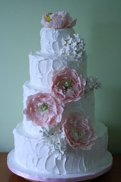 I love this wedding cake style. The non-perfect icing job is cute and I think I could do this homemade.