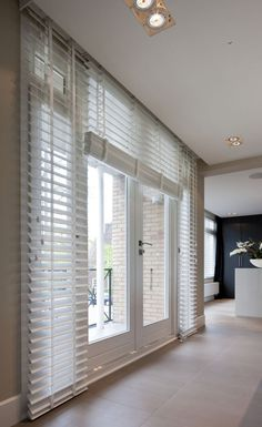 White wooden blind adds beauty to home with discovering privacy.