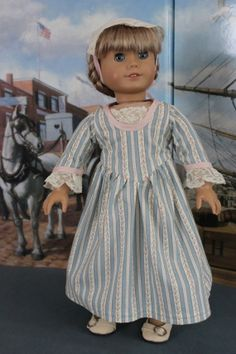 American Girl Doll Clothes  Colonial Style by ForAllTimeDesigns, $58.00 (C105)  The idea for this outfit started with wanting to make use of this beautiful vintage ticking that I found online. I settled on a Colonial dress and then selected the lace and pink silk for the edging from my lace and fabric stashes.  Although not very visible in this photo, I also made a pinner cap using a wonderful oval vintage doily of Normandy lace.