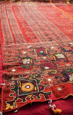 A beautiful vintage bedcover from India. Embroidered over hand block printed cotton and finished with small shells. Also make lovely wallhanging. From Bringing It All Back Home. http://bringingitallbackhome.co.uk/shop/embroidered-printed-indian-bedcover/