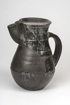 """Viking Jug, 9th century Ceramic Björkö, Adelsö, Uppland, Sweden Tating-ware type pottery with tin foil decoration. At At the lower part of the jug motifs of the Christian cross has been applied """