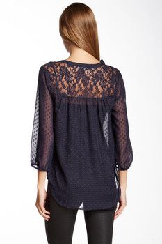 Dear Stylist: If you have this, I love it! I love that this Daniel Rainn Lace Yoke Swiss Dot Blouse has sheer sleeves and has intricate lace detailing at the top.I love this shade of blue, the sheer and flowing 3/4 length sleeves, the length of the shirt.. Great shirt for the fall!