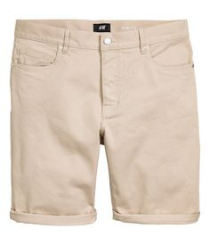 Beige. 5-pocket shorts in stretch cotton twill with a regular waist, button fly and slim legs. Slim fit.